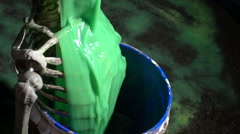 Slime on skeleton pouring toxic substance waste Stock Footage