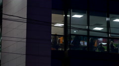 People Working Late In The Night, Doing Overtime To Meet Deadline, Pan Stock Footage