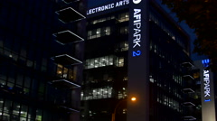 Pan Over Illuminated Office Buildings In Bussines Center Late At Night Stock Footage