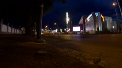 Light Traffic Late At Night In Front Of Illuminated Bussines Center Stock Footage