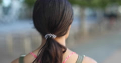 Young female walking down street Stock Footage
