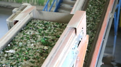 Glass waste in recycling facility. Glass particles in a machine. Line Stock Footage