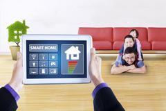 Controller applications of smart home on tablet Stock Photos