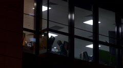 Sneak Peek In An Office Where People Are Working Late At Night Doing Overtime Stock Footage