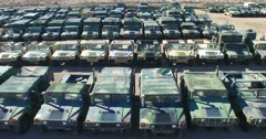 Aerial over a military vehicle storage depot. Stock Footage