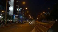 Busy Avenue In Front Of Bussines Center Late At Night, Still Shot Stock Footage