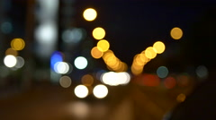 Busy Avenue In Front Of Business Center Late At Night, Rack Focus Stock Footage