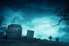Creepy atmosphere in the cemetery with tombstone Stock Photos