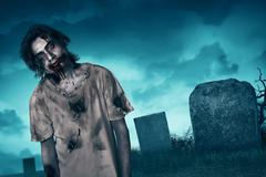 Zombie walking with creepy expression Stock Photos