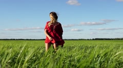 Happy woman enjoying nature beautiful blonde dancing on field. Freedom concept. Stock Footage