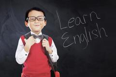 Schoolboy with text Learn English - stock photo