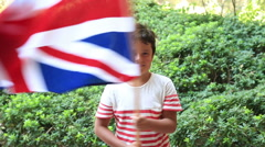 Little boy smiling and waving England flag outside 3 Stock Footage