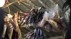 Man buys dried fish. Stock Footage
