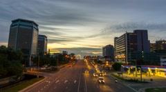 Sunset to Night Traffic Flow at Karamunsing Flyover Kota Kinabalu Stock Footage