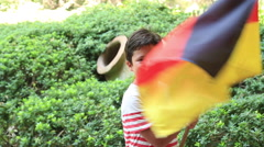 Little boy smiling and waving Germany flag outside Stock Footage