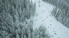 Aerial view winter mountains and ski slope Carpathians Stock Footage