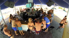 People relax at the bar near the pool Stock Footage