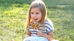 Little girl with a lollipop Stock Footage
