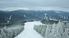 Aerial view winter ski resort mountains Carpathians Stock Footage