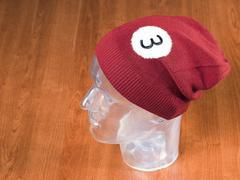 Red woolen handmade cap basketball ball alike Stock Photos