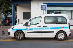 Closeup of the body of the police car with a sign POLICE. Stock Photos