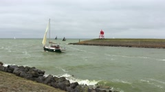 Sailboat leaving the harbour during strong wind Stock Footage