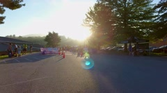 Aerial preparing for morning triathlon in staging area Stock Footage
