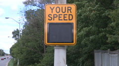 Radar sign measuring speed of traffic and cars Stock Footage