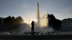 Young woman photographs fountain Stock Footage