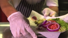 Chef prepares  Crazy Burger meal  Stock Footage