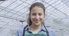 4K Portrait of cheerful worker in the agriculture industry holding seed tray Stock Footage