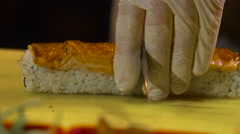 Chef divides Salmon Sushi Roll Stock Footage