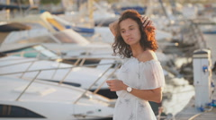 Beautiful woman thinking about life on a pier on a summer day thinking about Stock Footage