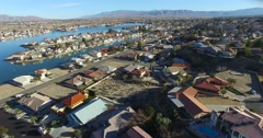 Aerial over a suburban neighborhood in the desert with an artificial lake Stock Footage