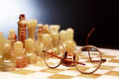 Spectacles On Chessboard Stock Photos