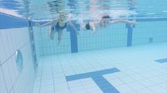 Underwater children in aquapark Arkistovideo