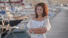 Beautiful happy woman on a pier on a summer day Stock Footage