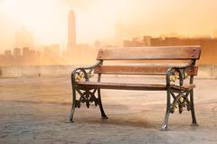 Vintage color tone of antique wooden bench  with sunrise Stock Photos