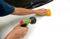Asian Mans Hand Cleaning Front Bonnet Car With Sponge And Squirt Water Hose Stock Footage