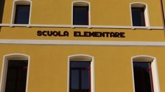 "An Italian primary school with ""Scuola elementare"" written on the facade Stock Footage"