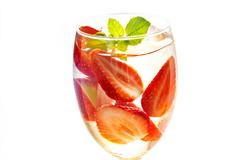 Glass refreshing drink of strawberry with mint on white background Stock Photos