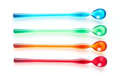 Colorful spoon on white background Stock Photos