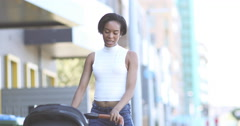 Afro-american mother walking with stroller Stock Footage
