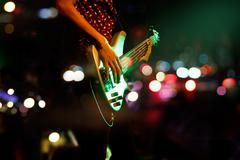 Guitarist on stage abstract colorful background, soft and blur concept Stock Photos