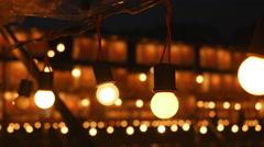 Illuminated light bulbs at festival Stock Footage