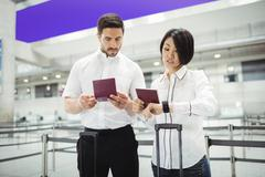 Business man and woman checking their passport Stock Photos
