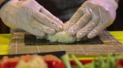 Chef prepares sushi roll with rice Stock Footage