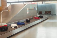 Luggage on the baggage carousel Stock Photos