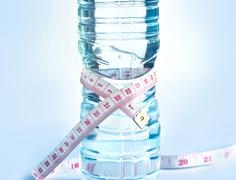White measure on water bottle shape, healthy drink concept Stock Photos