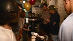 People gathered at coffee making on table Stock Footage